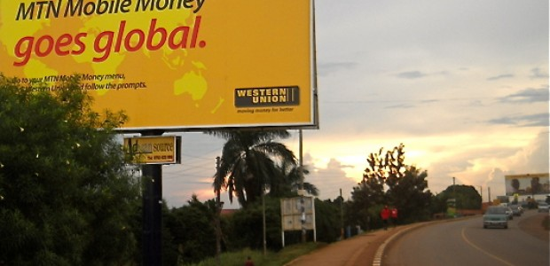 """MTN mobile money goes global"" advertisement in Kampala, May 2012."