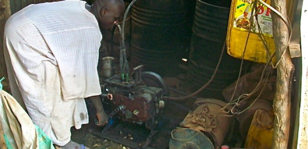 A businessman in Juba tries out an old generator he uses for lighting and refrigeration.