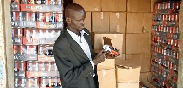 An officer checks the expiry dates of goods in Kuajok, November 20.