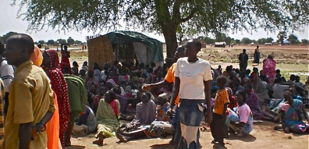 Women in Aweil wait as an NGO distributes food on April 20, 2012.