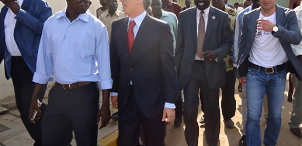 Luis Figo (left) alongside F. Zandi, Chairman of Star Petroleum and South Sudan Football Association and government officials after Figo's arrival, Juba airport, March 4.