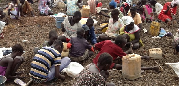 Women and children in Bentiu dig and collect gavel, May 8.