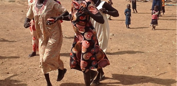 Returnees in Bentiu dance in joy after officials announce that land has been allocated for the returnees, March 1.