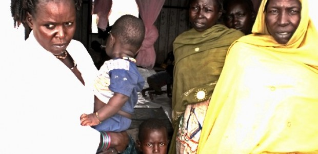 A nurse carries a refugee child from Sudan's troubled Nuba Mountains region upon arrival at the registration centre in Rubkonta County, Unity State, September 13.