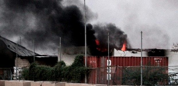 A burning building in Khartoum, September 26, following violent protests in Sudan's capital.
