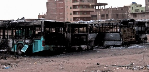 Burnt busses in Sudan's capital Khartoum, September 26.