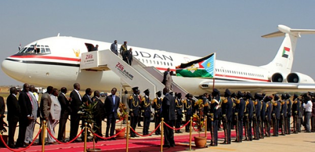 South Sudanese Cabinet Ministers receive Sudanese President Omar Hassan al-Bashir at Juba International Airport on Monday, January 6.