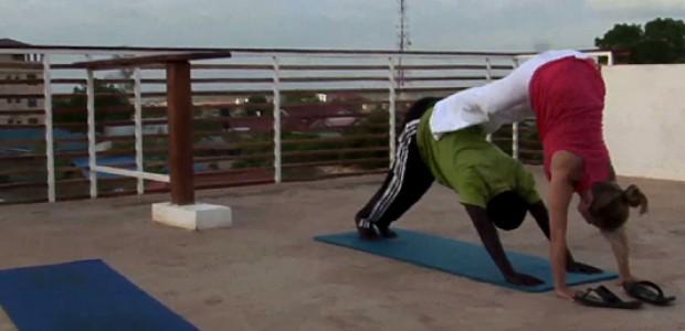 Naomi Swain and The Niles correspondent Simon Bingo during a Yoga session in Juba, May 2013.