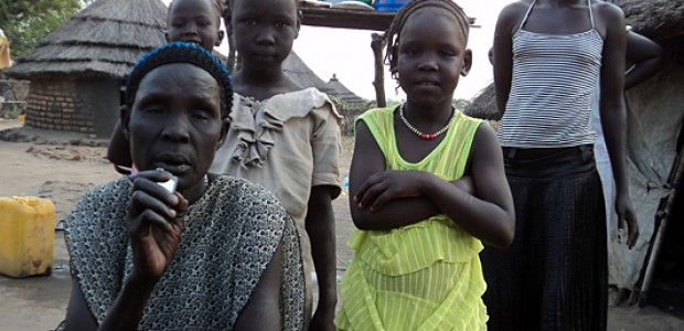 Martha Ajah (left) and some of the displaced children she shelters in Nimule, Feb. 6.