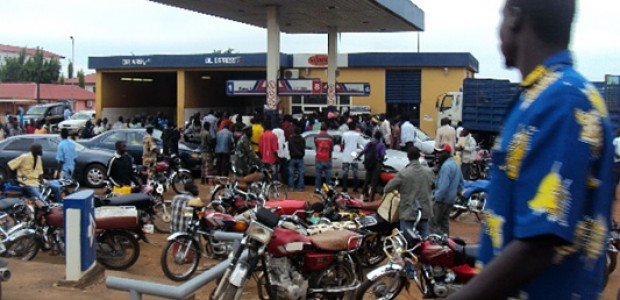 Boda boda (motorbike taxi) drivers waiting for fuel at Imatongas station along Juba's Ministries Road, February 14, 2012.
