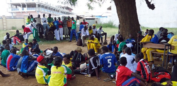 The Warrap State Girls' Football Team taking a break after a training at Juba Commercial Secondary School compound, August 22, 2013.
