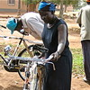 A community-based midwife receives a bicycle to facilitate her work in Yei County, December 2005.