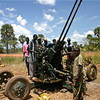 SPLA combatants posing in front of their artillery at Yei airstrip, October 16, 2006.