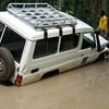 A car stuck on one of South Sudan's feeder roads.