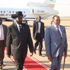 AU chairman Mutharika (R) was met by Presdent Kiir (L) on a visit to Juba.
