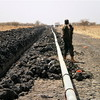 A SPLA soldier guards a pipeline under construction in South Sudan's Unity State, April 4, 2012.