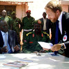 Head of the Red Cross' delegation to South Sudan, Melker Mabeck (right) and South Sudanese Ministry of Defence's spokesperson, Kuol Deng Abot Kuol (left) sign documents during the release of Sudanese soldiers in April.