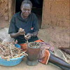 An old woman is preparing Sorghum in Magwi, June 16.