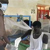 A medical staff attending to one of the patients in the Juba Military Hospital.