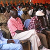Youths look on as the facts of cattle theft are discussed.