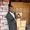 An officer checks the expiry dates of goods in Kuajok, November 20.