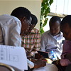 A group of men filling out visa application forms at the South Sudan Embassy in Kampala, November 19.