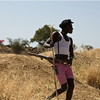 A cattle herder in the Nuba Mountains, December 2012.