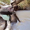 A child in Pokula Boma fetches water, January 28.