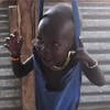 A malnourished child is weighed at a feeding centre in Aweil, February 25.