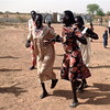 Joyful returnees dance to welcome Unity State officials in Bentiu's transit camp, March 1.