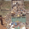 A lorry dumps garbage in Yei, March 21.