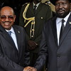 South Sudan's President Salva Kiir and Sudan's President Omar al-Bashir shake hands in Juba, April 12.