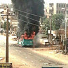 A bus burning in Omdurman following violent protests on September 25.