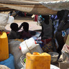 Displaced women and children under an improvised shelter on the UNMISS compound in Juba, Jan. 3.