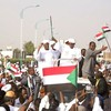 Crowds applaud the Sudanese President after Addis Ababa breakthrough, September 28.