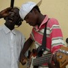 Musician Lawrence Aloro (left) in Yei