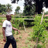 Gakiza Allan Joseph in his passion fruit garden in Nzara, South Sudan, August 6, 2015. (photo: The Niles | Joseph Nashion)