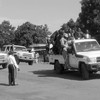 A convoy with government officials drives through Yei in 2015.