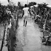 A woman tries to safe her property from floods in South Sudan's Unity State on August 9, 2013.