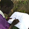 Geography exercise: a child draws a map of South Sudan\'s ten states.