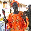 An elderly lady in Yei, dancing and waving, the symbol for secession.