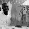 Deng Majid Chol displays a painting during an exhibition in Juba, June 19, 2016. (photo: The Niles | Gale Julius)