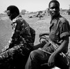 Two soldiers of the Sudans People Liberation Army - North on the back of a pick up truck in South Kordofan's Nuba Mountains region, April 24, 2012. (photo: Marc Hofer)