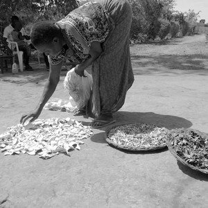 A woman in Northern Uganda dries vegetables in the sun.  (photo: The Niles | Martha Agama)