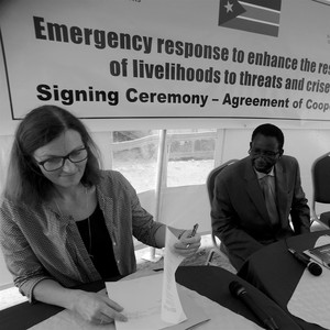 Norwegian Ambassador to South Sudan Tone Tinnes (left) and Animal Resources and Fisheries Minister James Janka Duku (centre) during the signing of the cooperation agreement in Juba, June 2016.                 (photo: The Niles | Akim Mugisa)