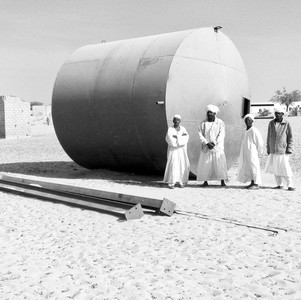 Members of the local committee in Alshigeag Aljaalien show The Niles a new water tank on March 17, 2018. (photo: The Niles | Elzahraa Jadallah)