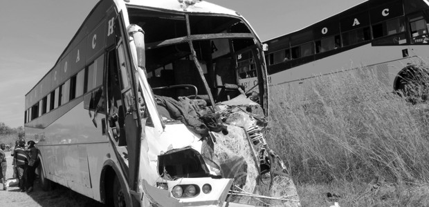 A head-on collision on November 12, 2014 between a passenger bus traveling from Kampala and a truck on the Juba to Nimule roadway that left at least 3 people dead. (photo: The Niles | Davis Mugume)