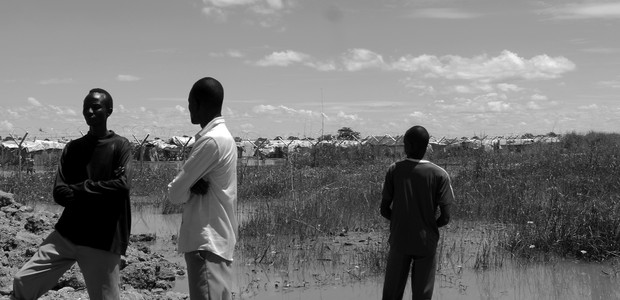 Young men in front of the UNMISS POC camp in Bentiu, October 10, 2014. (photo: The Niles | Waakhe Simon)