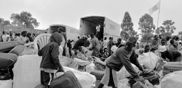 Displaced people loading their belongings on a truck in Keri, preparing for their relocation to a refugee settlement, July 20, 2016. (photo: The Niles | Male Daniel)