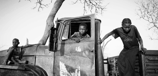 Nubian children play on a broken down military truck on the outskirts of the Yida refugee camp. (photo: The Niles | Marc Hofer)